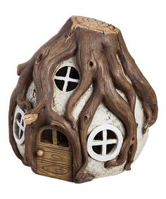 Add a touch of whimsy to your outdoor décor with this darling fairy house that features a durable polystone construction, artfully crafted detailing and a lighting feature that plugs in to provide illuminating ambience at night.