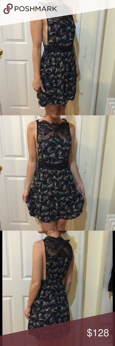 FREE PEOPLE Midnight Dotted Scalloped Lace Dress Free People Blue dotted dress with blue lace detail along the top front and back with a scalloped hem. Stretch elastic at waist band- no closures. Super cute and above knee length! Worn once or twice! Free People Dresses