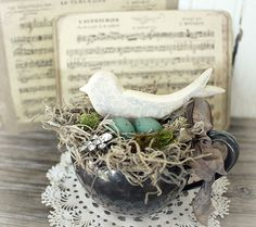 A sweet little birdy and nest tucked into a vintage silver plate creamer!