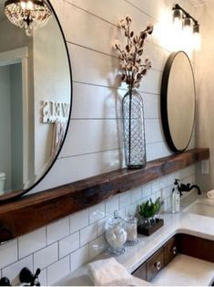 I love this collection of farmhouse bathrooms. These bathrooms are stunning. The perfect touch of farmhouse and rustic. shiplap bathroom, farmhouse bathroom, subway tile, wood beam, rustic bathroom