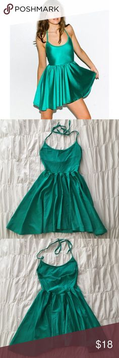 American Apparel Nylon Tricot Figure Skater Dress Turquoise/ shiny green halter skater dress. Worn twice and in excellent condition! American Apparel Dresses Mini