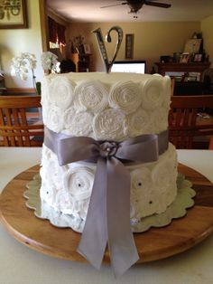 Rose christening cake. Vanilla bean cake with a dolce de leche filling on the bottom and chocolate cake with a raspberry Swiss meringue butter cream filling on top.