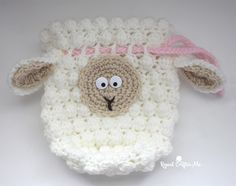 Purse designs these days are all about reflecting your unique personality. This Fluffy Sheep Drawstring Crochet Bag Pattern gives your handmade bag a lamb's warm, woolly character. The free crochet pattern includes a curious face and floppy ears. Crochet Sheep, Free Crochet Bag, Crochet Pouch, Crochet Shell Stitch, Easter Crochet, Crochet Pillow, Crochet For Kids, Crochet Toys, Bag Pattern Free