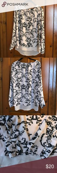 The Limited long sleeve shirt NWOT Size medium pink shirt with gray and black print. This is new without tags, had been a gift.  Both cuffs have cute 4 button detail as does the back of the neck. The Limited Tops Blouses