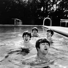 Having conquered America during their brief but historic first visit, John, Paul, George and Ringo relax in a Miami Beach pool in February 1964 before returning to London. See more here. (John Loengard—Time  Life Pictures/Getty Images)