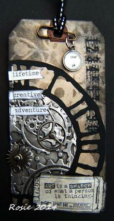 January 2014 (Tim Holtz 12 tags challenge) - by Rosie Schirrmeister at Rosie's Bastelwelt. Lots to see at her blog but have to dig to find this tag - no tutorial.