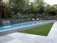 Sophisticated raised lap pool with modern detailing and water fall feature. Modern Lap Pool, Raised Lap Pool Swimming Pool Shades of Green Landscape Architecture Sausalito, CA Pool Spa, Modern Landscaping, Backyard Landscaping, Pool Backyard, Driveway Landscaping, Tropical Landscaping, Swimming Pool Designs, Swimming Pools, Lap Pools