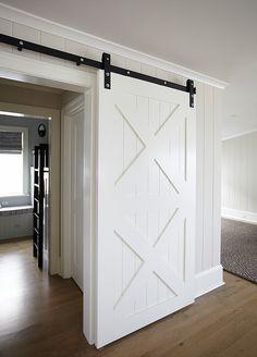A sliding barn door creates a sense of privacy to the bunk room.