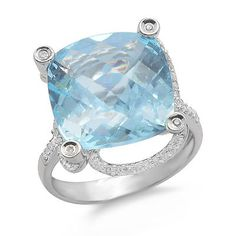 A gleaming cushion shaped prong set large blue topaz gemstone sits atop this 14k white gold ring. The gemstone is accented by 48 round brilliant diamonds. The diamonds have H/I color and SI2/I1 clarity.Different ring sizes may be available. Please inquire for details. $507.00 Blue Topaz Diamond, Topaz Gemstone, Gemstone Rings, Cushion Cut, White Gold Rings, Diamond Rings, Cushions, Ring Sizes, Gemstones