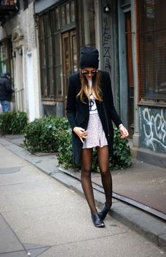Lengthy cardigan, pale pink mini skirt, graphic tee and basic beanie