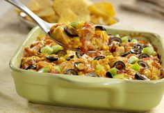 Monterey Chicken Tortilla Casserole - this dish uses leftover tortilla chips layered with chicken, Pace Picante, corn, green pepper, olives and cheese.