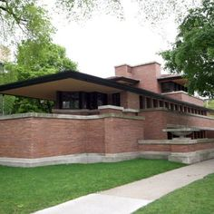 Frank Lloyd Wright Robie House - Chicago  low hip roof  deep over hang  horizontal emphasis  windows and brick rake  raised living areas  simplicity   open plan between living and dining was completely open except for fire place  concealed entrance   windows concealed from continuous band  urns with plants on projections  best example of prairie style  no basement
