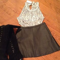 """BCBGMAXAZRIA Lined Pleather Black Skirt A Line Style Black Pleather Lined Mini Skirt from BCBGMAXAZRIA. Side Zipper with Elastic Band in the back for added comfort and fit. Perfect Mini skirt to wear with over the knee boots!! Waist is 13 1/2"""". Length is 15"""". Perfect condition, never worn!! BCBGMaxAzria Skirts Mini"""