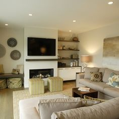 Electric Fireplace Design Ideas, - built ins, a place to store ottomans and poufs