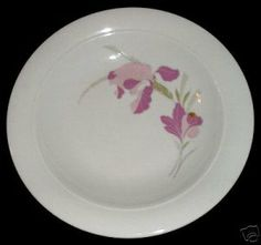 "Porcelain rimmed soup bowl with floral pattern. Quantity Available: 1 Size: 8 5/8"" diameter, 1 3/8"" high  Age: probably c. 1980s  Colors: pale pink/medium pinkish-lavender/pale sage green/light olive green on white  Marks/Labels: Kahla German Democratic Republic 25  Condition: Very Good,no chips,cracks or crazing, a few tiny utensil scratches"