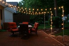 How to make inexpensive poles to hang string lights on caf style support poles for patio lights made from rebar and electrical conduit aloadofball Choice Image