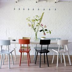For matched chairs, paint them all different colors (or consider subtle, Pantone-esque gradient of chairs around table).
