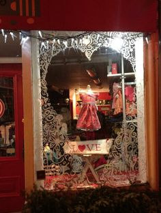 Use cut vinyl to frame your window displays.  Even use a heart to add a valentine theme.