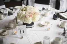 Blush and Ivory wedding flower centerpiece - blush garden roses and astilbe, champagne spray roses, and white hydrangeas. Photo taken by Andreas Impressions Photography.  For more beautiful blush wedding flower ideas check out http://www.weddingflowerbuzz.com/blush-wedding-flowers.html#blush-wedding-flowers