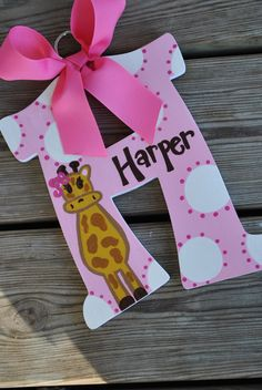 Would be cute in Kason's colors for small wall...WHIMSICAL GIRAFFE  Handpainted Letter (Set). $11.99, via Etsy