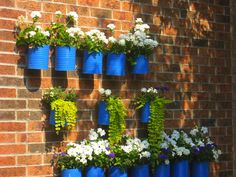 be sure to to paint with outdoor paint. Could attach to a wood board to reduce how many holes needed in your brick.