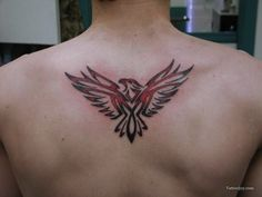 small eagle on back | eagle tattoos