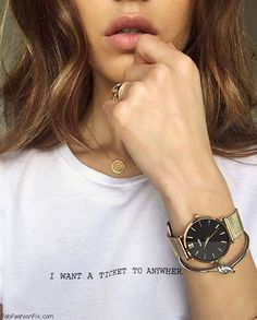 Negin Mirsalehi wearing Cluse Watches Minuit collection. #clusewatches #golden