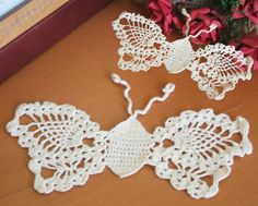 With a substantial design that draws on tradition, our hand Crochet Lace butterfly doilies recall childhood memories of grandmother's crochet. Perfect as a doily or coaster. Great craft items. Excellent for decorating t-shirts, jeans & tote bags. 100% cotton. Imported. Color: Ecru.