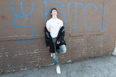 Flaunt Magazine | People: Shawn Mendes ALEXANDER WANG coat, THE EVIL ROCK N ROLL CAT vintage t-shirt, and GUESS jeans.