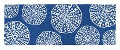 A beachcombers gathering of white sea urchin shells make up the pattern of this dark blue wool hooked accent runner size rug.