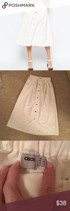 ASOS white midi Never been worn- white midi with front gold button detail with pockets. Just lovely.  Perfect like new condition. ASOS Skirts Midi