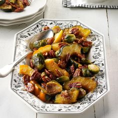 Roasted Acorn Squash & Brussels Sprouts Recipe -I love creating dishes with few ingredients and easy steps, like squash with Brussels sprouts. Maple syrup adds a slight sweetness, and pecans give it a toasty crunch. —Angela LeMoine, Howell, New Jersey