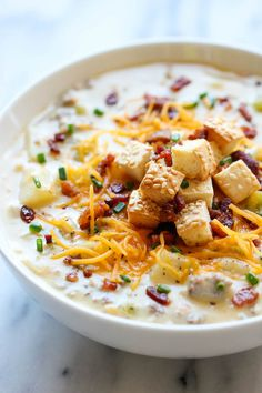 Cheeseburger Soup - All the flavors of a cheeseburger in a creamy, comforting soup, topped with crisp bacon bits and hamburger bun croutons!