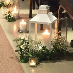Simple, classy aisle decor - white lanterns with ivy and baby's breath Lantern Centerpiece Wedding, Winter Wedding Centerpieces, Wedding Lanterns, Wedding Table Centerpieces, Centerpiece Ideas, Bottle Centerpieces, Centrepieces, White Lanterns, Candle Lanterns
