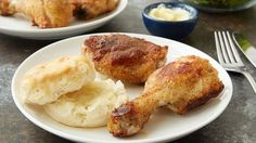 Make the perfect weeknight dinner for two with this tasty oven-fried chicken and biscuits recipe. The chicken and the biscuits are baked on the same pan -- less dirty dishes and a super-easy cleanup. The biscuits taste extra special with a spread of honey-infused butter!