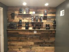 Pallet wall for Jack Daniels collection for my husband with shelving.....manly office idea!!!