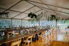 White Roof Marquee | Festoon lights | Integrated Timber Flooring | Vintage Timber Tables | White Padded Folding Chairs | Wooden Folding Chairs | South Coast Party Hire