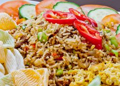 Indonesian Nasi Goreng served with Veggie Chips, Slices ofCucumber and Tomato, and Scrambled Tofu   Indonesian fried rice also called Nas...