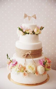 Such a pretty cake for an extra special bridal shower! Customize the bunting banner for the couple of honor - Vintage Style Wedding Cake