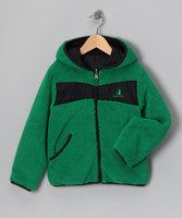 This fuzzy jacket has a super-soft faux shearling exterior with little pockets and a zipper in front. Pop that cozy hood on and, no matter the weather,little ones will stay nice and toasty. This plush piece is also completely reversible.100% polyester exclusive of decorationMachine wash; tumble dryImported