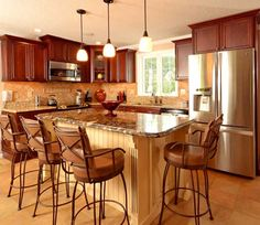 Fieldstone Cabinetry Glen Cove door style in Cherry finished in