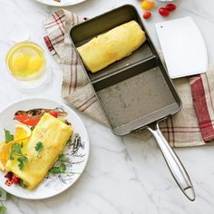 Nordic Ware Rolled Omelette Pan ~ Center divider provides a guide for filling placement and assists you in rolling your omelette.   Spatula helps you roll the cooked omelette over the filling and onto your plate. Watch Video