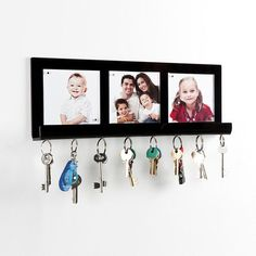 A modern great looking wall mounting key holder with strong magnets to hold a selection of keys and photo pocket holders to personalise the key rack and create a unique eye catching holder for your entrance hall.