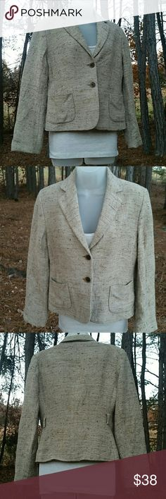 """Banana Republic 2 Button Blazer Very nice stylish beige/wheat blended color with 2 pocket front and 2 brown button closures. Fitted style with two 2"""" belt loops on back sides, belt not included. Cream color lining. Pre-loved but almost brand new condition, no holes or stains. Can provide a model pic if truly interested. **True to size**  Woman's size Medium  Measurements are as follows: Arm inseam 17"""" Arm length from shoulder seam to outer wrist 23"""" Pit to pit across back 22"""" Length from…"""