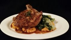 Pork chop in garluc sauce with mashed yams, and bok choy