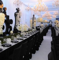 Kim Kardashian Black and White Wedding recycled glass chandeliers, sustainable and organic cotton fabrics, organically grown flowers and organic paints