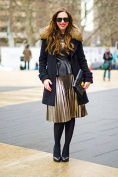 Carrie wears an Andrew Marc coat, H&M skirt, Cole Haan shoes, and Forever 21 bag.