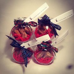£1.50 will get you four IKEA spice jars just like this. Jazz them up with some tartan ribbon, drop in some Edinburgh Rock or home made tablet and you're good to go. Alternatively, you can buy the ready-filled jars above from this Etsy shop.