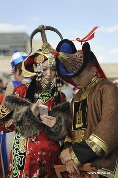 Mongolian ethnic costume invitational tournament in Xilinhot city, North China's Inner Mongolia autonomous region, Aug 8, 2013