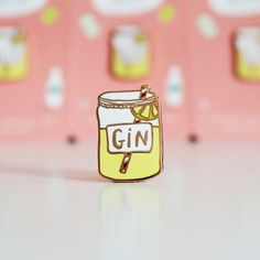 Just the tonic... A hard enamel luxury Gin Pin. This pin is perfect for anyone who loves gin! It is made from hard enamel with a rose gold colour finish making it eel really luxurious! The pin measures H25mm x W12mm and has a yellow rubber stopper clasp at the back to keep it securely on your clothes or bag.  It comes on a Gin Pin card as seen in the photos and will arrive wrapped in tissue paper and a ready to be given as a gift.  Perfect gift for lapel pin collectors, a great secret santa…